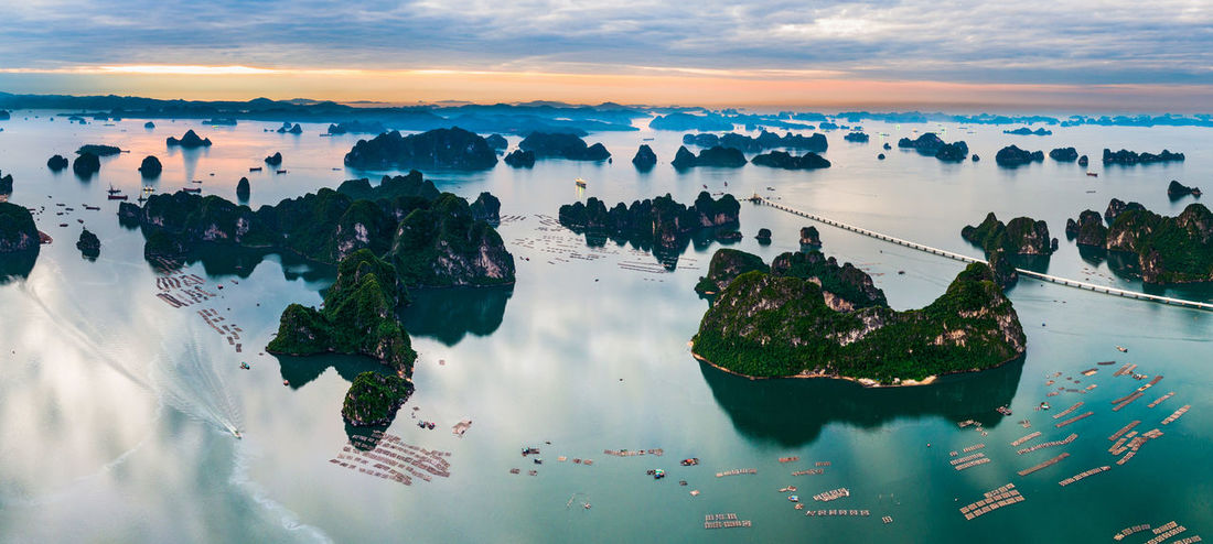 Bai Tu Long Bay Halong Bay Vietnam Architecture Beauty In Nature Building Exterior Built Structure City Cityscape Cloud - Sky Day Ha Long Bay Halong Nature Nautical Vessel No People Outdoors Scenics Sea Sky Sunset Water