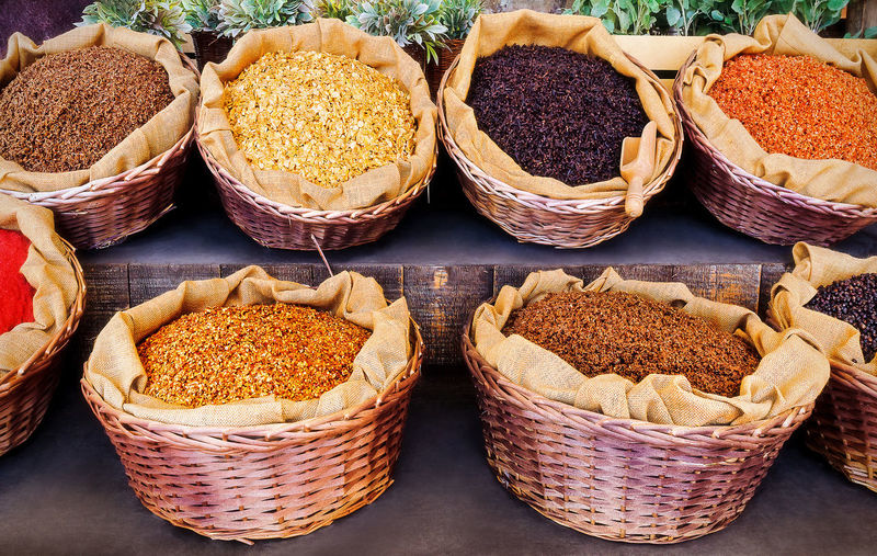 Various grains in baskets at market stall