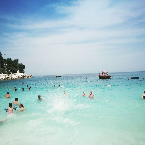 Water Beach Vacations Tourist Resort Sea Summer Sunny Blue People Swimming Relaxation Nautical Vessel Sky Large Group Of People Travel Destinations Outdoors Nature Horizon Over Water Day Adult