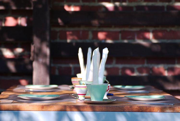 Crockery on table at sidewalk cafe
