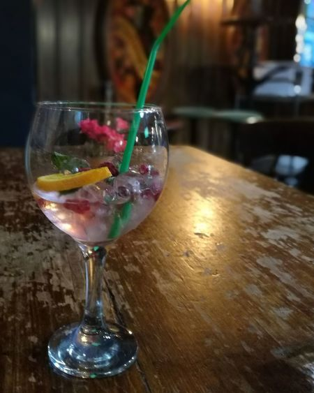A snazzy gin Bar GoingOut Nightlife Drinking Drinking Straw Alcohol Drink Wineglass Cocktail Drinking Glass Table Martini Glass Close-up Food And Drink GIN Tonic Water Ice Cube Aperitif
