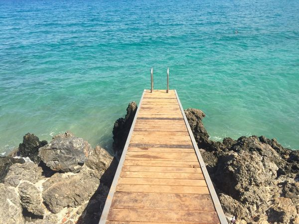 Water Sea Pier The Way Forward Tranquility Tranquil Scene Blue High Angle View Wood - Material Scenics Rippled Nature Day Sunny Beauty In Nature Diminishing Perspective Outdoors Calm Summer Shore Greece Crete