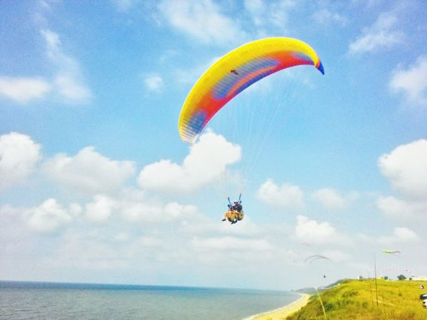 Flying Mid-air Extreme Sports Parachute Paragliding Leisure Activity Sky Cloud - Sky Day Multi Colored Outdoors RISK Adventure Sport People Nature Aerobatics One Person