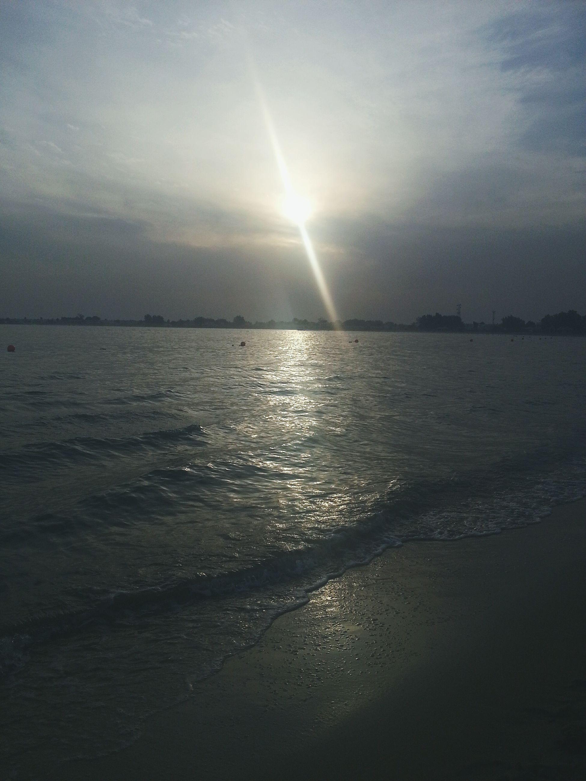 water, sea, tranquil scene, scenics, tranquility, sky, horizon over water, beauty in nature, sun, beach, reflection, nature, sunset, shore, idyllic, cloud - sky, sunlight, sunbeam, waterfront, remote