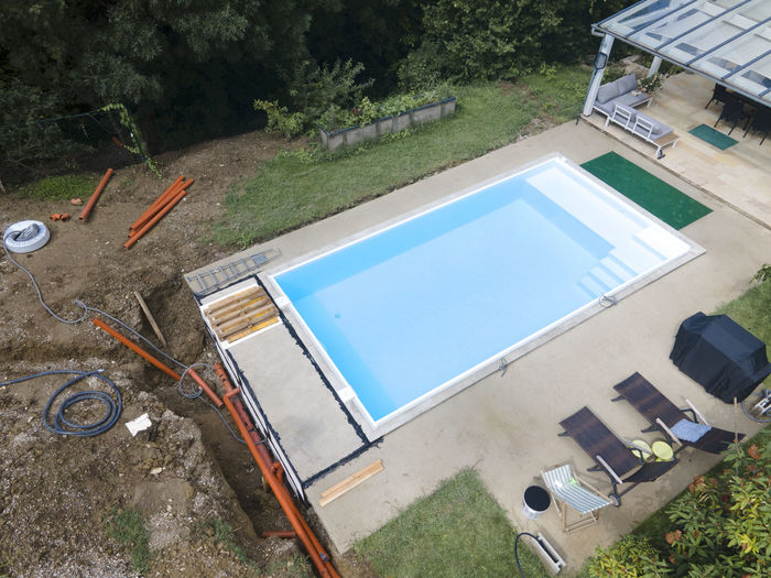 High angle view of swimming pool in field