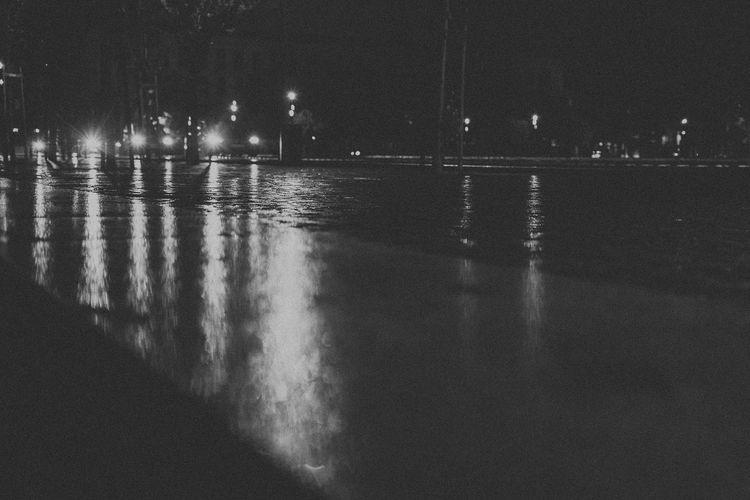 Architecture Black And White Cars Headlight Illuminated Night Nightphotography No People Old Town Outdoors Rain Rainy Rainy Days Reflection Reflection Sky Water