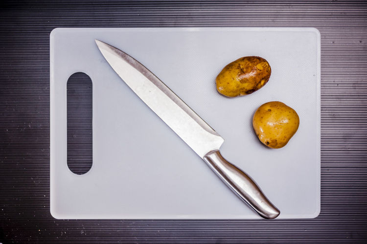 Chopping Board Commercial Cooking Cutting Boards Cuttlery Food Foodphotography Ingredients Kitchen Knife Objects Potatoes Stainless Steel Knife Still Life Photography Subject Vegetable