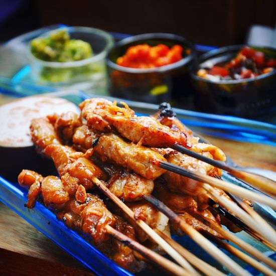 Close-up of food in skewers on plate