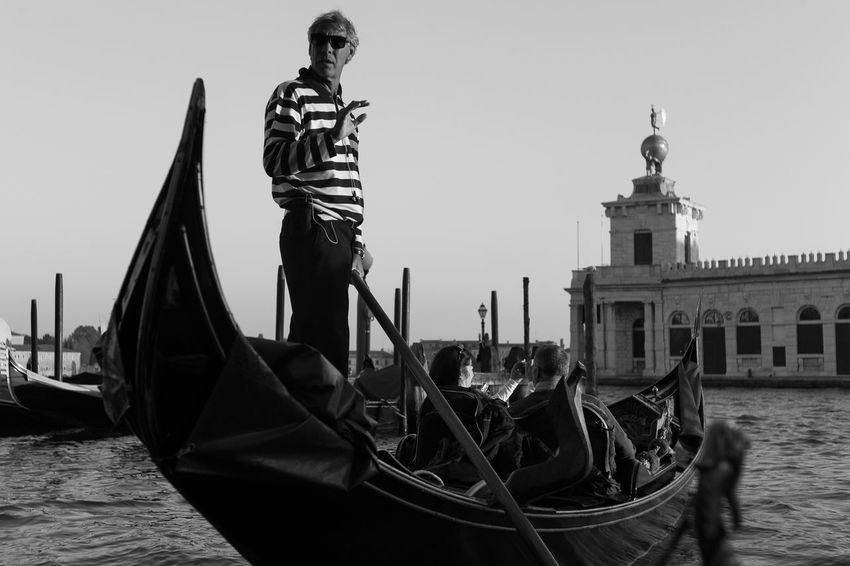A gondoliere guides his boat into Venice's Grand Canal. Image © Brian Kerrigan 2016 Boat Boatman Canal Famous Place Gondola Gondoliere Italy Mode Of Transport Tourism Transportation Venetian Venice Water