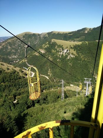 Beauty In Nature Day Green Color Growth Landscape Mountain Nature No People Outdoors Overhead Cable Car Scenics Ski Lift Sky Tranquil Scene Tranquility Tree