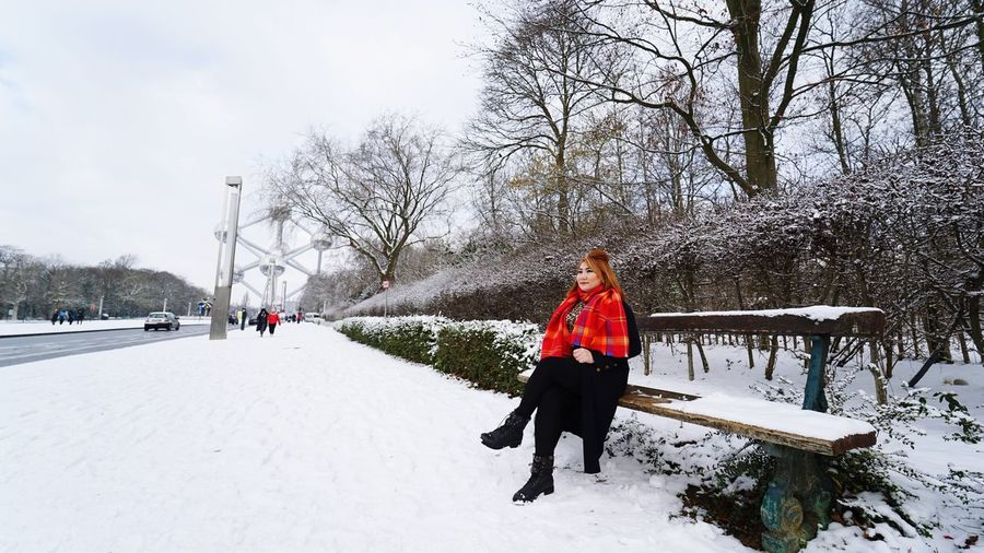 feels like the time almost freeze for a while Snow Covered Lone Young Women Brussel Atomium Cold Weather Travel Destinations Travelphotography Warm Clothing Ice Rink Tree Snow Cold Temperature Full Length Winter Sports Clothing Young Women Winter Sport Cold White International Landmark