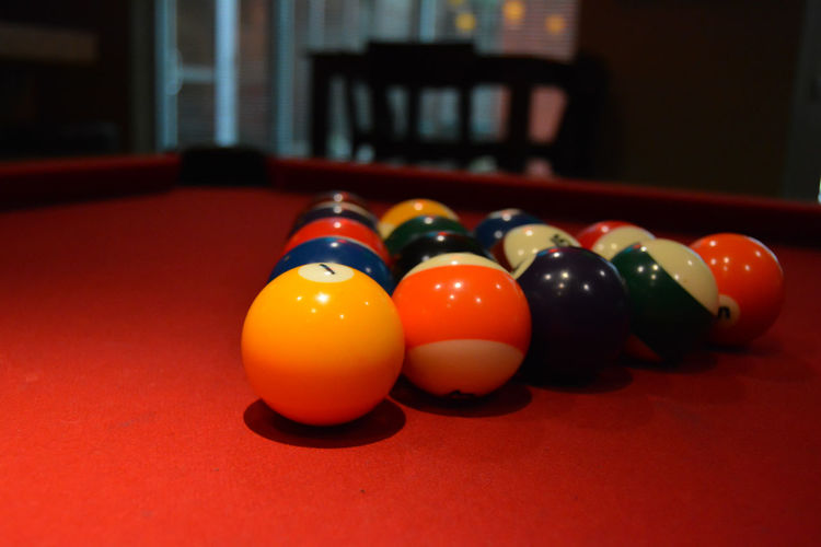 Close-up of billiard balls on pool table