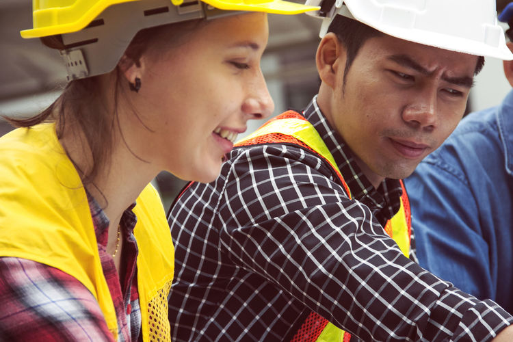 Engineering planning and looking white paper close up. Construction Construction Site Meeting Planning Building Building Story Construction Industry Coworker Design Professional Engineer Engineering Hardhat  Headwear Helmet Looking Men Occupation People Real People Structure Teamwork Togetherness Two People Working Young Men