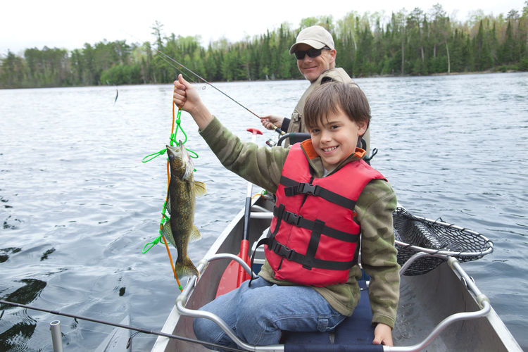 Portrait Of Boy Holding Fish