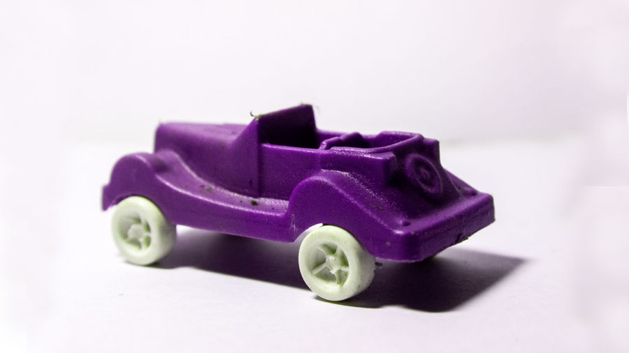Close-up of toy car against white background