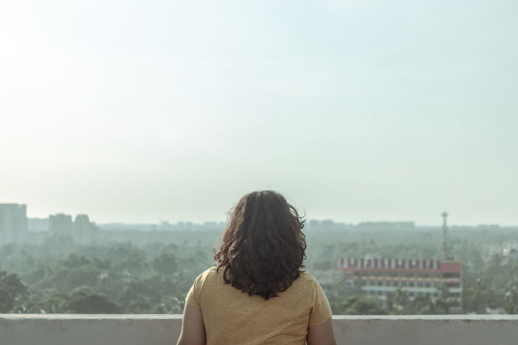 For the film look Kolkata Newtown City Cityscape Young Women Women Rear View Standing Urban Skyline Sky Architecture Human Back Residential Structure Tall - High Looking At View Building