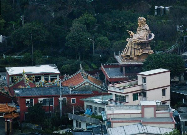 Aerial view of the Daoist God of War statue, looking over the town of Jinguashi, on Taiwan's north-east coast. God Of War Guan Yu Jinguashi Jinguashih Ruifang District Taiwanese Worship Architecture Belief Building Exterior Built Structure Daoist Day Growth Jiufen No People Outdoors Religion Roof Sculpture Statue Tree