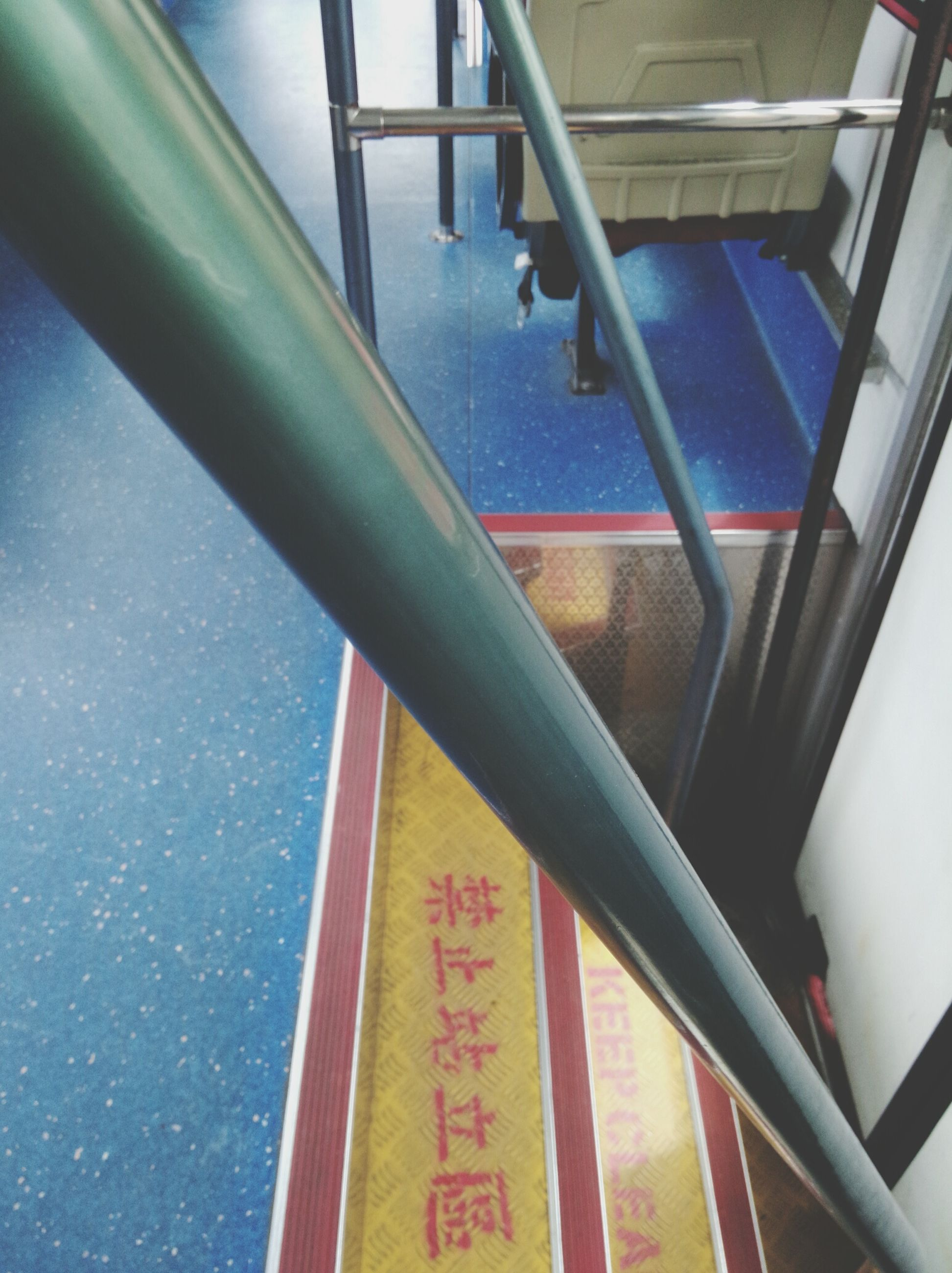 indoors, railing, built structure, architecture, metal, high angle view, day, window, no people, metallic, sunlight, blue, close-up, part of, pattern, transportation, low angle view, glass - material, cropped, steps