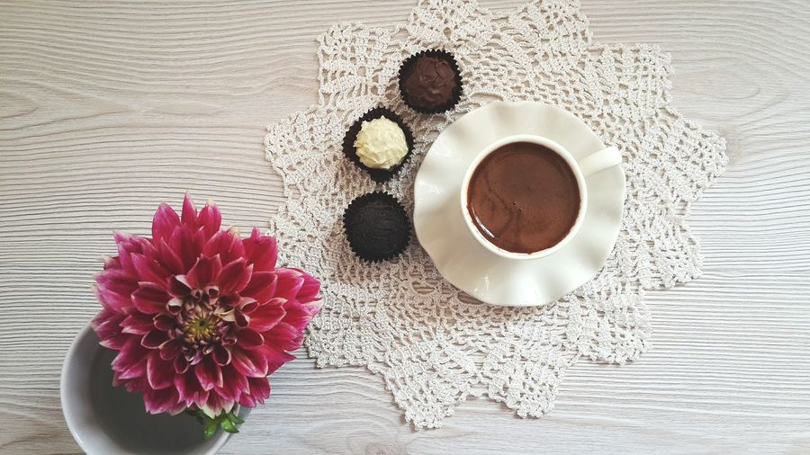 Directly Above Shot Of Coffee Cup With Chocolate On Table
