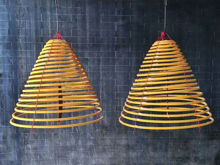 2 hanging large insence coils Temple Incense Coil No People Yellow Hanging Side By Side Arrangement Celebration Religion Pattern Outdoors The Mobile Photographer - 2019 EyeEm Awards The Minimalist - 2019 EyeEm Awards