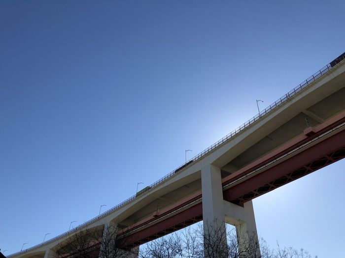 Low angle view of road bridge against clear blue sky in Lisbon, Portugal Lisbon Portugal Built Structure Architecture Sky Low Angle View Clear Sky Bridge Bridge - Man Made Structure Nature Day No People Connection Blue Transportation Architectural Column Building Exterior Outdoors City Overpass Copy Space Elevated Road