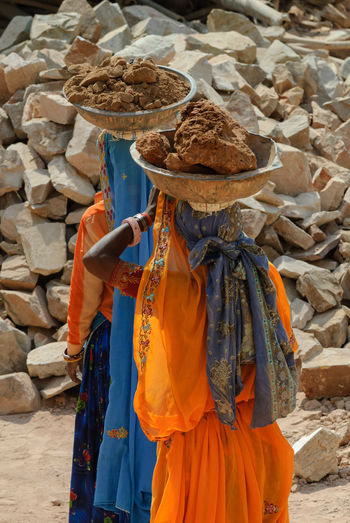 Women doing hard labor on historical sites in Rajasthan Amber Construction Hard India Manual Labor Woman Working Working Hard Amber Fort Carrying Clothing Hard Labor Labour Outdoors Palace Rajasthan Real People Saree Standing Traditional Clothing Women