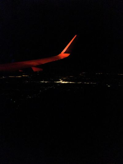 Airplane flying in sky at night
