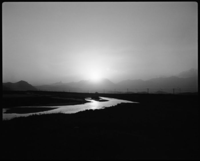 The natural bliss of Kaesong Tourist Zone Analogue Photography ASIA Black And White Border DMZ, North Korea, South Korea DPRK Ideology Kaesong Kim Il Sung Kim Jong Il Korean Mountains Medium Format Mountains Mural Nature North Korea Peaks Plaubel Makina 67 Propaganda River Sunset Rocks Sunset Tourist Zone