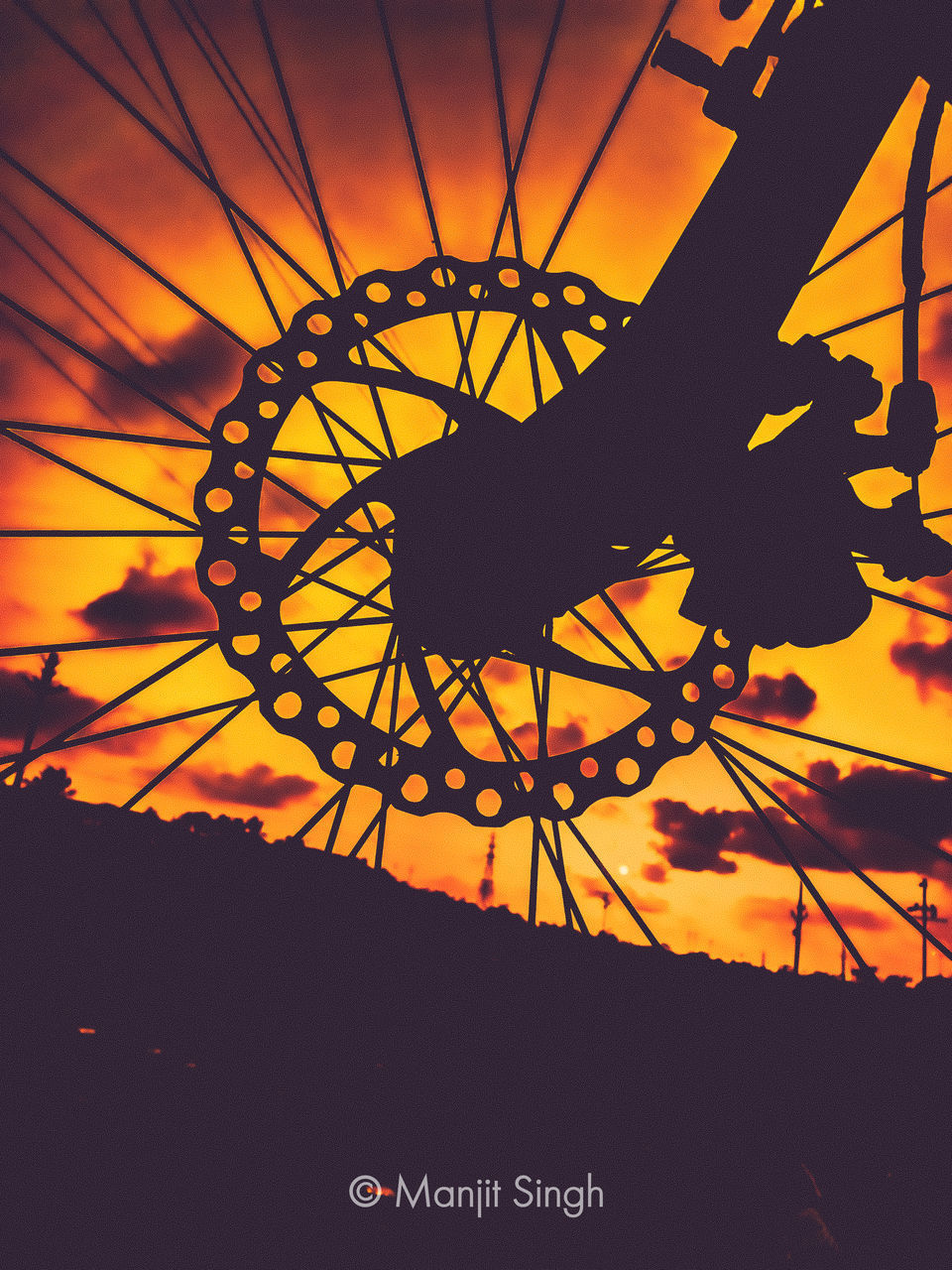 CLOSE-UP OF SILHOUETTE ROLLERCOASTER AGAINST SKY AT SUNSET
