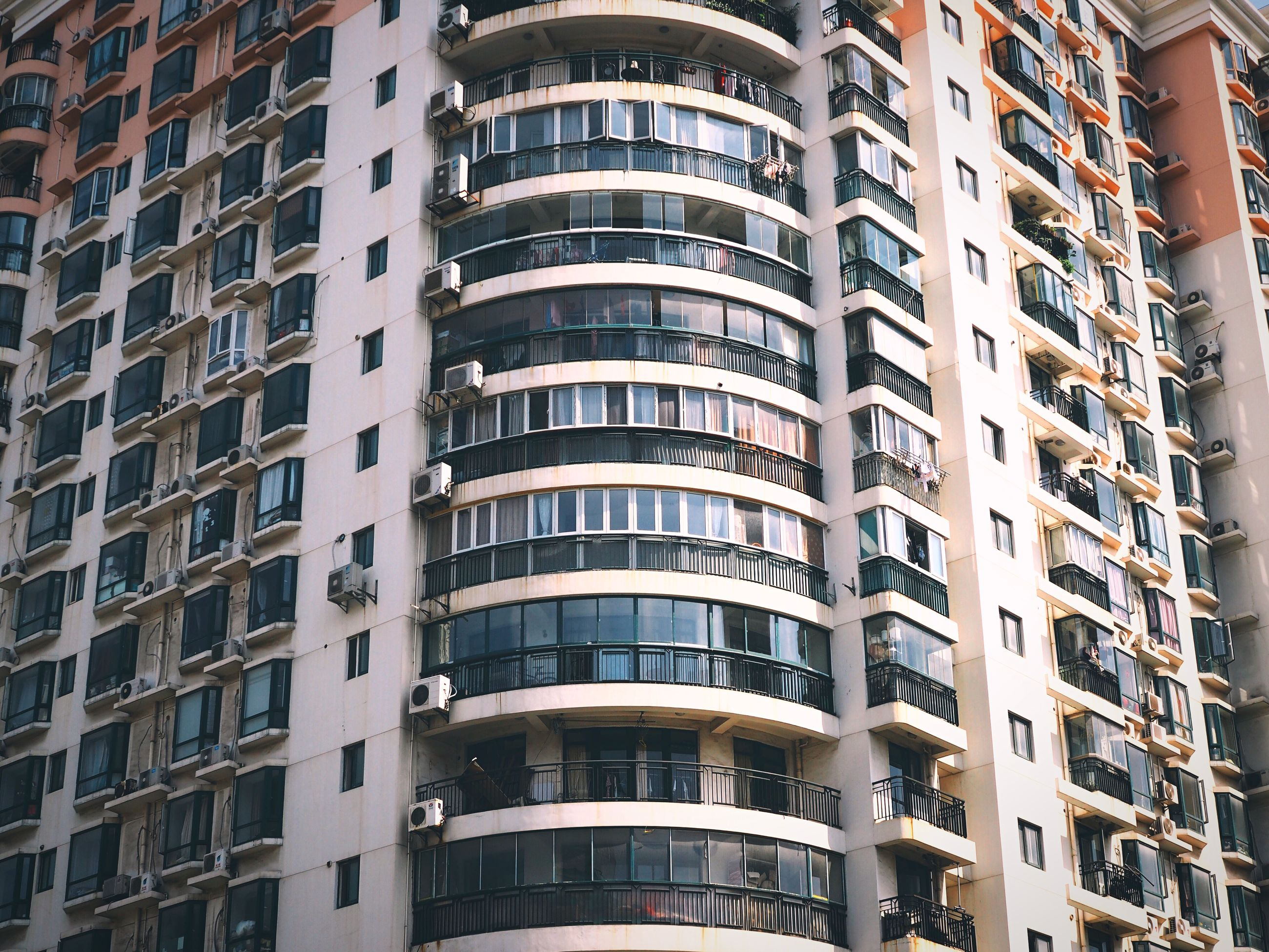 architecture, building exterior, built structure, window, city, low angle view, building, residential building, apartment, balcony, residential structure, repetition, full frame, modern, in a row, office building, backgrounds, city life, day, no people