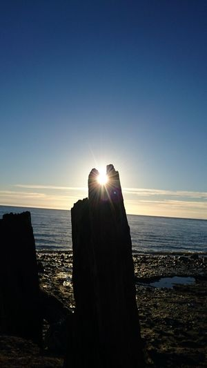 eye of the sun Hanging Out Taking Photos Check This Out Enjoying Life Wood Wooden Post Sea And Sky Weathered Silouette & Sky Walking Around Beuty Of Nature Amazing Nature Blue Amazing Color Palette Color Palatte Enjoying Life Check This Out Taking Photos Sky Beutiful Nature