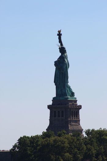 Ellis Island  Ellis Island / Statue Of Liberty Liberty Park Statue Of Liberty United States Architecture Blue Built Structure Clear Sky Day Female Likeness Freedom History Human Representation Low Angle View New York Harbor No People Outdoors Sculpture Sky Statue Tourism Travel Travel Destinations Tree