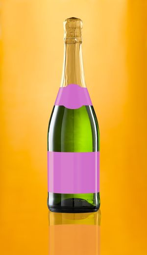 Bottle wine on golden background Food And Drink Spumante Isolated Feast Golden Gold Pink Champagne Wine Blank Label Label Bottle Cork - Stopper Alcohol Yellow Studio Shot Wine Bottle No People Drink Close-up Freshness