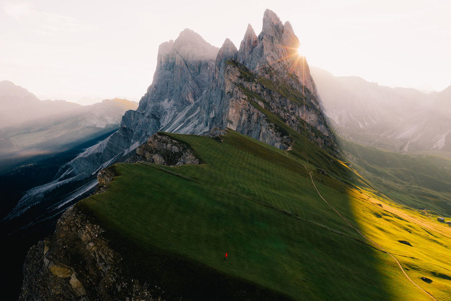 Sunrise over Seceda, Italy. Taken with the Mavic 2 Pro Dolomites Dolomites, Italy Drone  Aerial View Australian Photographers Beauty In Nature Dji Dronephotography Environment Landscape Lens Flare Mavic Pro 2 Mountain Mountain Peak Mountain Range Nature Non-urban Scene Ortisei Outdoors Scenics - Nature Seceda Sunlight Sunrise Week On Eyeem A New Beginning Autumn Mood A New Perspective On Life