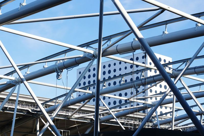 A Bird's Eye View Arena Architecture Steel Structure  Built Structure Modern Building Exterior Grid Blue Sky Geometric Shape Architectural Feature Tall - High Engineering Famous Place