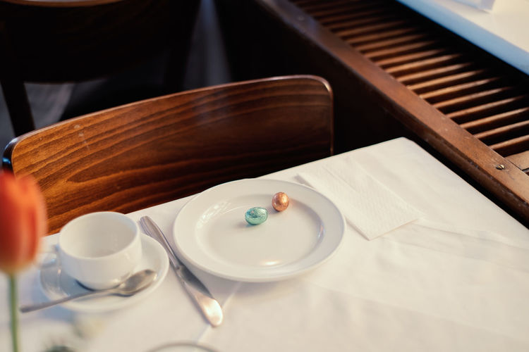 Springtime Decadence Easter Egg Easter Eggs Easter Table Indoors  Food And Drink Cup Plate Coffee Cup Mug Close-up No People Crockery Still Life Focus On Foreground Tray Household Equipment Cafe Bowl Kitchen Utensil Seat Empty Restaurant The Foodie - 2019 EyeEm Awards The Minimalist - 2019 EyeEm Awards