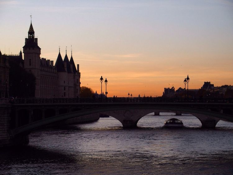 Nice sunset in Paris Architecture Bridge - Man Made Structure Built Structure Building Exterior River Sunset Connection City Travel Destinations Water No People Outdoors Sky Day Paris Laseine Sunset_collection Streetphotography Cityscape Architecture_collection Romantic