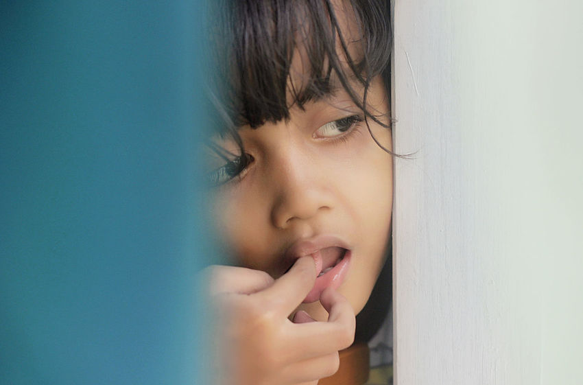 Peeping Childhood Close-up Day Elementary Age Girls Headshot Human Hand Indoors  Lifestyles One Person People Real People