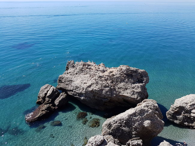 Water Sea Beach Rock - Object Tranquility Blue Shore Nature Day Tranquil Scene Outdoors Calm Beauty In Nature Coastline No People Rock Seascape Non-urban Scene Ocean Vacations Travel Destinations Nerja Andalucia Nerja Spain Beach Holiday