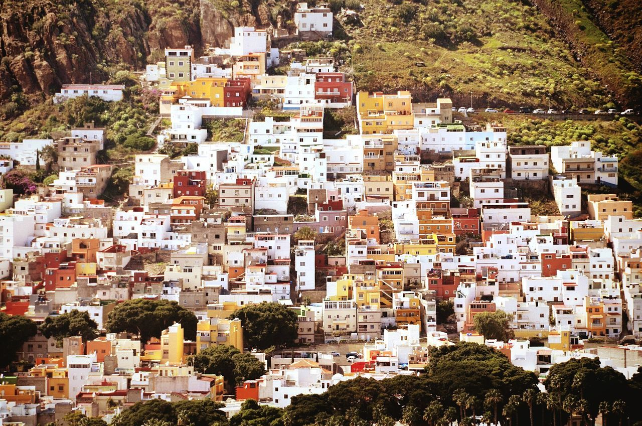 Low Angle View Of Town On Hill