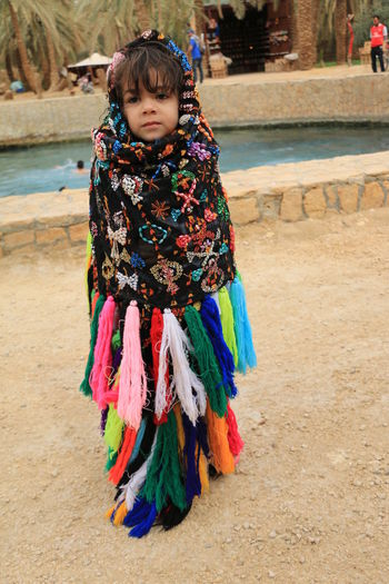 Full length of girl wrapped in colorful shawl