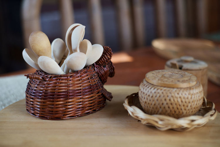 Close-Up Of Wooden Spoons In Basket On Table