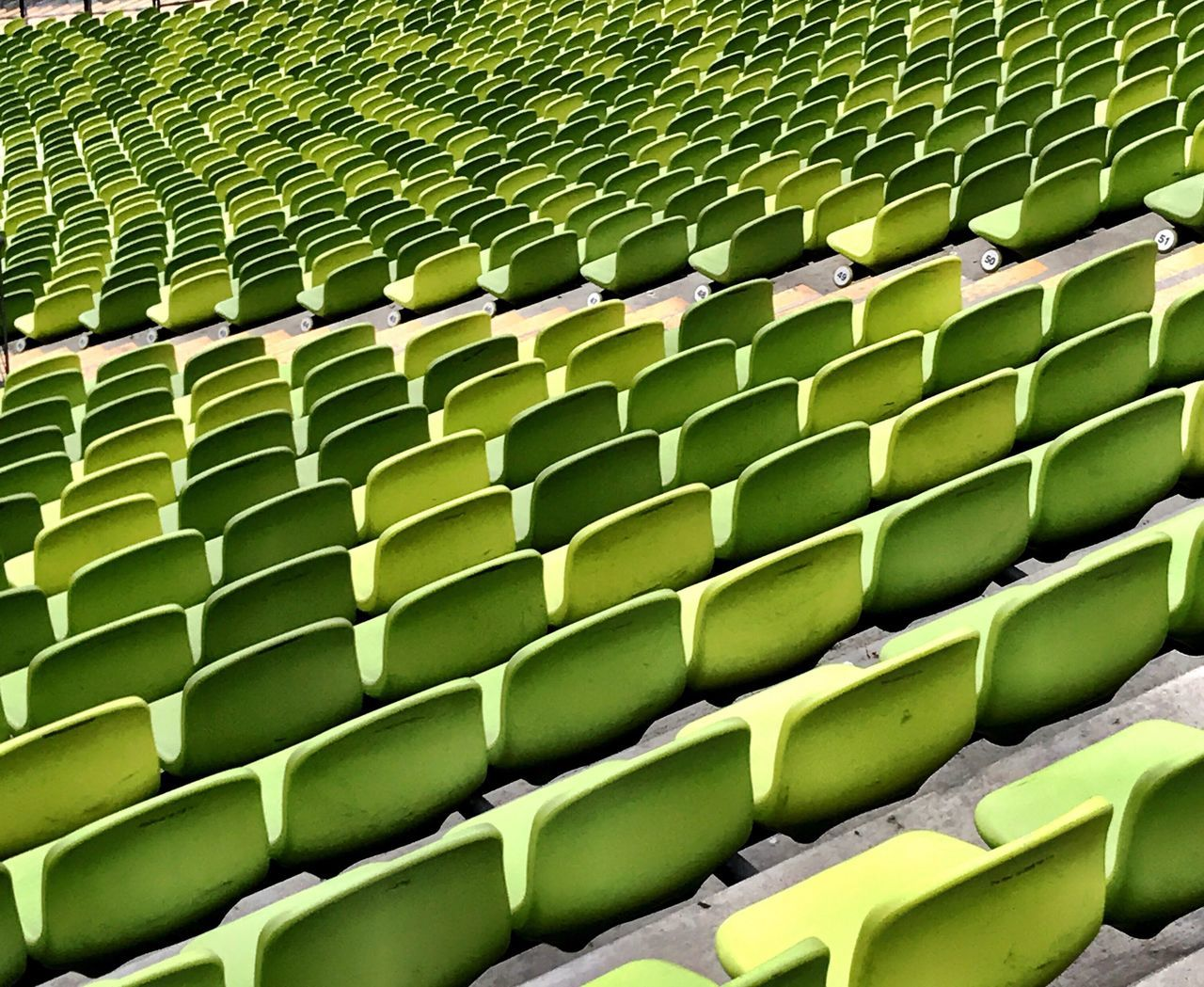 green color, in a row, abundance, indoors, no people, full frame, large group of objects, stadium, auditorium, day, close-up
