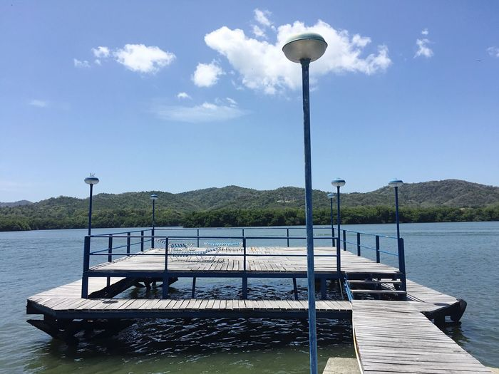 Street Light Water Day Sky Lighting Equipment No People Nature Outdoors Cloud - Sky Sunlight Lake Tranquility Scenics Nautical Vessel Beauty In Nature Mountain Solarium