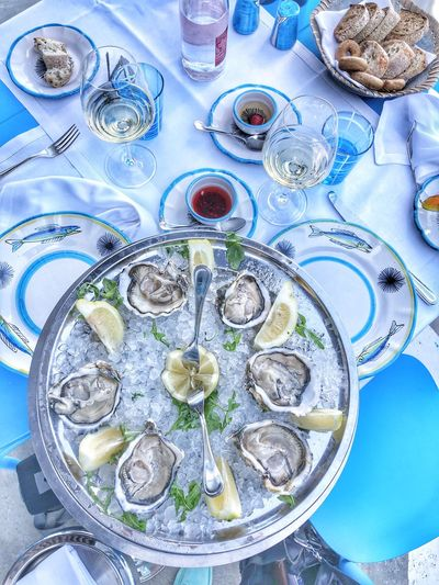 Oyster  Table Indoors  Plate High Angle View No People Still Life Food And Drink Food Blue