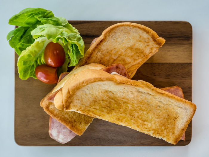 Panini ham and cheese, Italian delicious fast food. A panini or panino is a grilled sandwich made from bread other than sliced bread. Ham Isolated Toasted Bread Breakfast Brunch Directly Above Food Food And Drink Freshness Healthy Eating Lettuce Meal Panini Ready-to-eat Recipe Sandwich Snack Still Life Studio Shot Tasty Toasted Bread Vegetable Wellbeing White Background