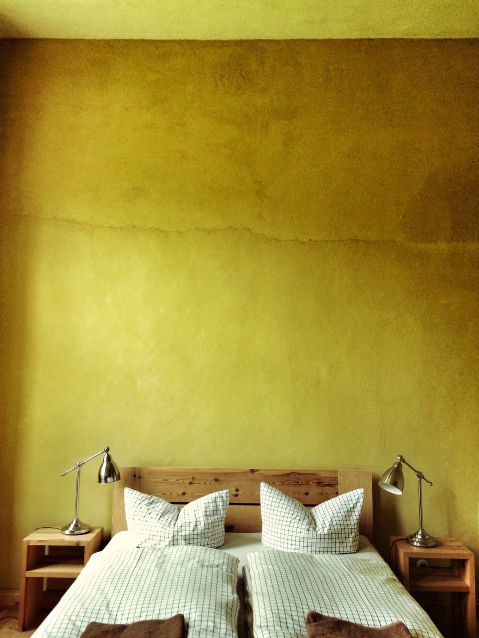 Interior of bedroom with yellow wall