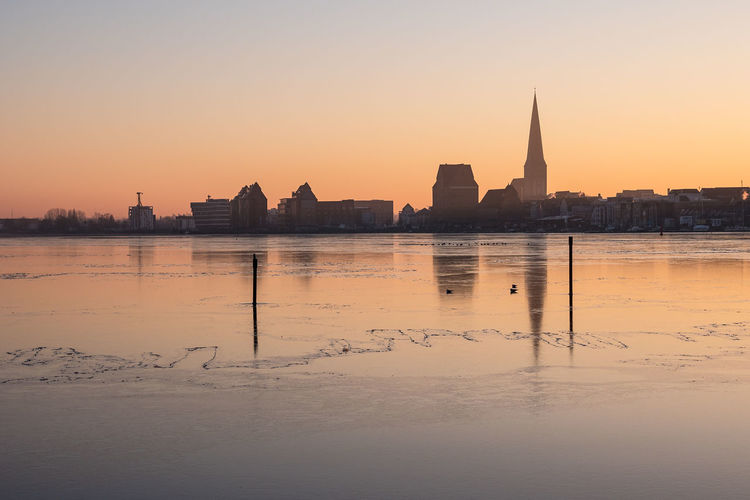 View over the river Warnow to Rostock, Germany. Architecture Building Exterior City Frozen Holiday Ice Journey Morning Light Nature No People Outdoors River Rostock Sky Snow Sunrise Sunset Sunup Tourism Town Travel Destinations Vacation Warnow Water Winter