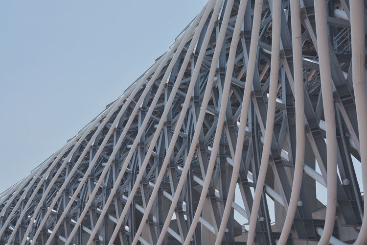 Kaohsiung National Stadium. Designed to look like a coiled dragon, its powered mostly through the vast solar array installed in the roof. Beautiful architecture. No People Kaohsiung Taiwanese Taiwan Patterns Sky Low Angle View Architecture Modern Day Outdoors ToyoIto Toyoitoarchitecture Abstract Design Clean Formosa National Stadium Stadium Steel Construction