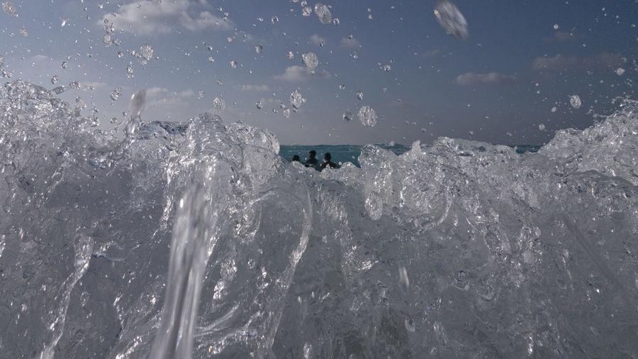 People enjoying in sea during winter